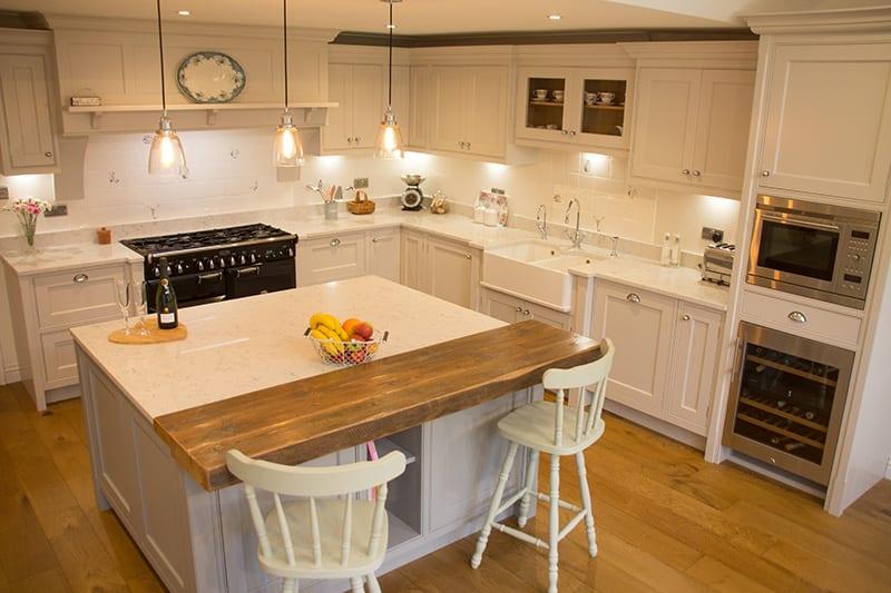 A modern oak breakfast bar on the kitchen island